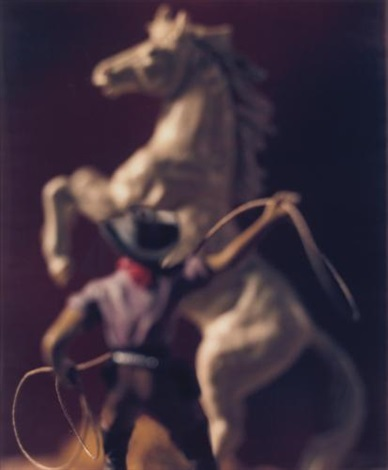 cowboy with lasso and white horse by david levinthal