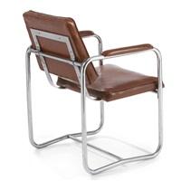 an armchair (from the philadelphia saving fund society building, philadelphia, pennsylvania) by william lescaze