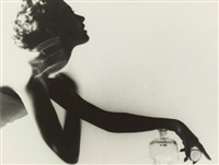 applying perfume for harper's bazaar by lillian bassman
