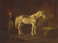 two horses and a groom in a stable by louis moritz