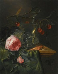 a still life with a cherry branch over a half-full conical roemer, red and green grapes, prawns, a ring, and two roses over a table by pieter de ring