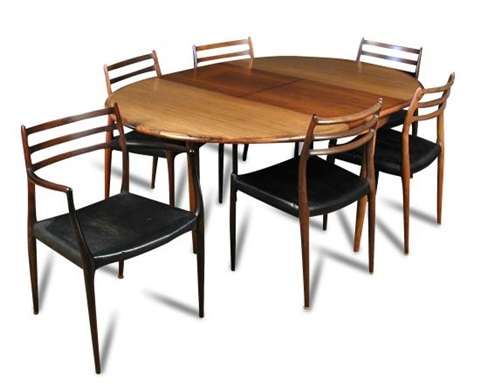 A Danish Rosewood Extending Circular Dining Table And Six Chairs By J L Moller