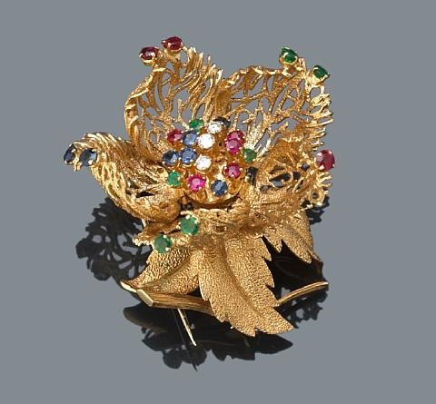 a flower brooch by robert altman
