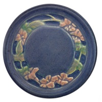 small circular trivet with trumpet vine by anna frances connor simpson