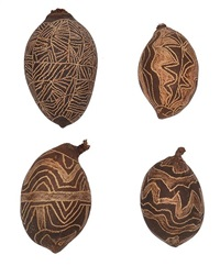 a group of four carved boab nuts by jimmy pike