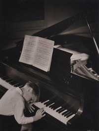 boy sleeping at piano by gordon h. coster