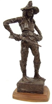 tall indian figure with cavalry belt. rifle and hat by hugh cabot