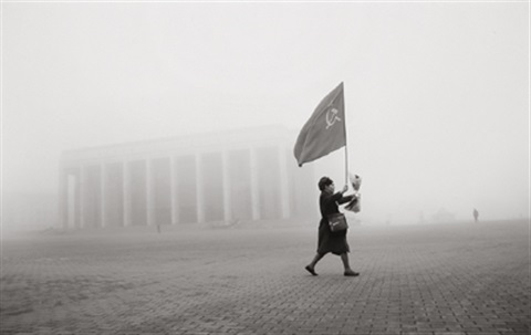 woman with the flag minsk belarus by andres liankevich