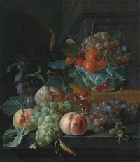 still life of fruit on a ledge and in a blue and white porcelain bowl by coenraet (conrad) roepel