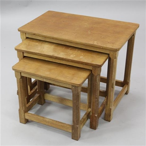 a nest of three robert 'mouseman' thompson oak occasional tables by robert thompson