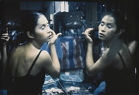 c putting on her make-up at second tip, bangkok by nan goldin