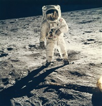 buzz aldrin's gold-plated sun visor reflects the photographer and the lunar by neil armstrong