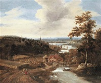 a wooded river landscape with harvesters and travellers on a bridge, a town beyond by gerrit (gerard) battem