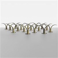 collection of seventeen candlesticks by ystad metall
