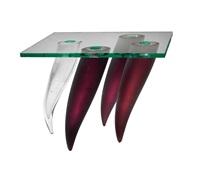 quatre etrangetés sous un mur side table by philippe starck