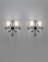 rare and important pair of yo-yo wall lights by jean royère