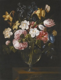 a still life of narcissi, daffodils, tulips, hollyhocks, hyacinths and other flowers in a glass vase on a stone ledge, with butterflies by juan de arellano