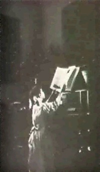 girl at piano by nell dorr