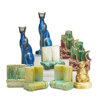book blocks: tall cats; books; tall ships (4 pairs); buddha by fulper pottery