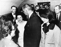 newly sworn-in president johnson, ladybird johnson and former first lady jackie kennedy on air force one by cecil, capt. stoughton