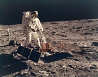 buzz aldrin standing next to the seismometer at tranquillity base, apollo 11, july 1969 by neil armstrong