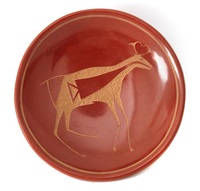 A Redware Small Plate With Sgraffito Antelope...