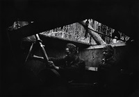 untitled (two men with machinery) by w. eugene smith