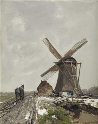 a snowy polder landscape with a windmill by louis apol