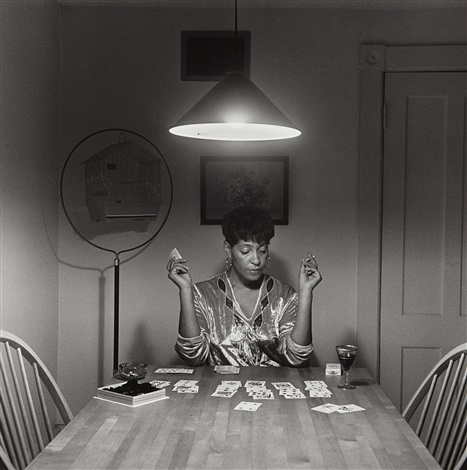 Unled Woman Playing Solitaire From The Kitchen Table By Carrie Mae Weems