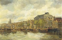 a view of the river amstel with the theatre carré, amsterdam by hendrik cornelis kranenburg