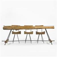 bar with set of three stools by sabena