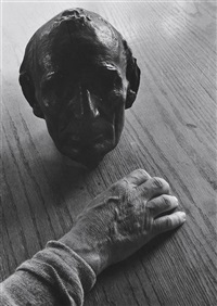 life mask of lincoln, hand of carl sandburg by edward steichen