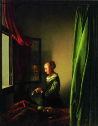 A woman reading a letter at a window