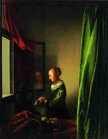 a woman reading a letter at a window by johannes van delft vermeer