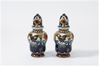 pair of lidded vases by haagse plateelfabriek (co.)