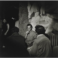 man with reefer, nude on wall, n.y.c. by larry fink