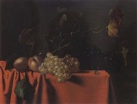 a still life of grapes, peaches and a nut, all on a table draped with a red velvet cloth by hendrick cornelisz van heemskerck