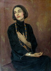 portrait of isadora duncan wearing a blue dress and colored bead necklace by paul swan