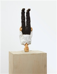 man standing on his head by stephan balkenhol