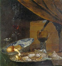 oysters on a silver platter, an orange and lemon in a bowl on a table by pieter gallis