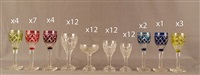 suite de plus ou moins soixante-neuf verres en cristal clair et doublé, pieds carrés, (set of 69) by val saint-lambert
