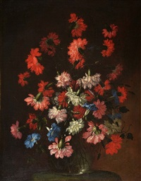 still life - a glass vase of mixed carnations upon a table by margherita caffi
