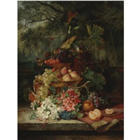 still life with grapes, cherries, peaches, and flowers in a double-tiered gilt dish, a carpet and an orange, all resting on a ledge with a balustrade and a garden landscape beyond by simon saint-jean