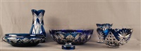 lot se composant d'une coupe sur piédouche, trois vases et deux raviers en cristal clair doublé bleu, (set of 6) by val saint-lambert