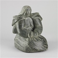 kneeling woman holding skin by siaja quarak ainalik
