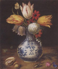 tulips, laurustinus, fritillaries, lily-of-the-valley and anemones in a delft vase, with a butterfly, a beetle, a cockroach and two shells by johannes walter