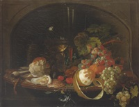 still life of a peeled lemon, grapes, an orange, cherries and walnuts together with a roemer, bread roll, oysters, a clay pipe and a taper on a wooden leaf by abraham mignon