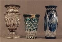 lot se composant d'un vase sur piédouche en cristal clair doublé fumé, un vase doublé bleu et un vase au décor de paniers fleuris (accident au col) (set of 3) by val saint-lambert