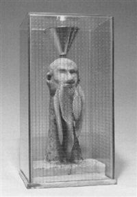 figural sculpture in glass box by richard wentworth