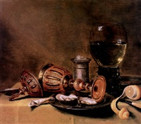 oysters on a pewter plate, an upturned cup and cover, a roemer and a silver salt on a draped table by gerrit willemsz heda